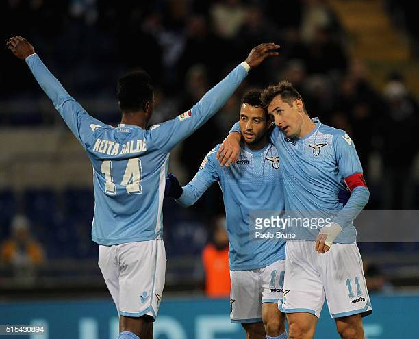 Miroslav Klose with his teammate Felipe Anderson and Diao Keita Balde of SS Lazio celebrates after scoring the team's second goal during the Serie A...