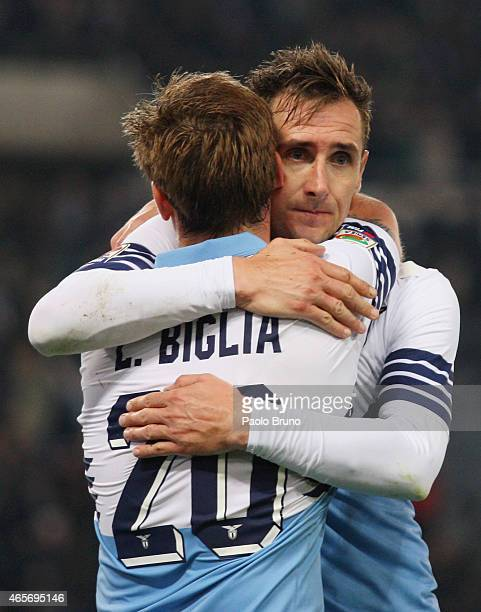 Miroslav Klose with his teammate Lucas Biglia of SS Lazio celebrates after scoring the third team's goal during the Serie A match between SS Lazio...