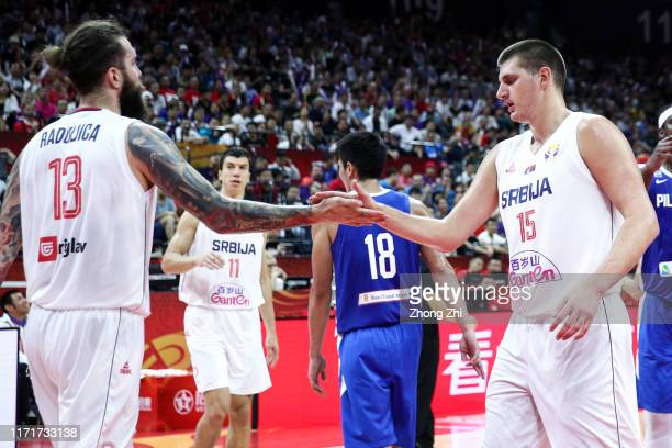 Miroslav Raduljica and Nikola Jokic of the Serbia National Team react during the match against the Philippines National Team during the 1st round of...