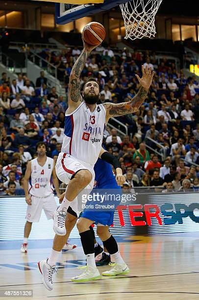 Miroslav Raduljica of Serbia drives to the basket against Italy during the FIBA EuroBasket 2015 Group B basketball match between Serbia and Italy at...