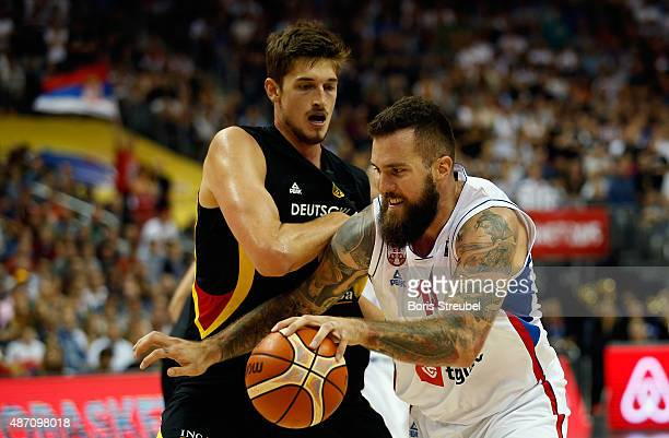 Miroslav Raduljica of Serbia drives to the basket against Tibor Pleiss of Germany during the FIBA EuroBasket 2015 Group B basketball match between...