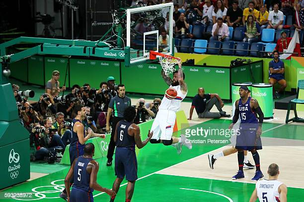 Miroslav Raduljica of Serbia dunks the ball aginst United States during the Men's Gold medal game on Day 16 of the Rio 2016 Olympic Games at Carioca...