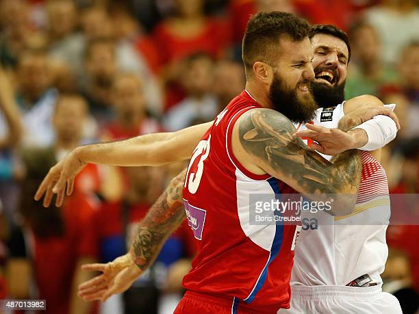 Miroslav Raduljica of Serbia fights for the ball with Nikola Mirotic of Spain during the FIBA EuroBasket 2015 Group B basketball match between Spain...