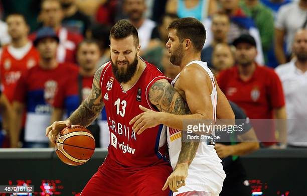 Miroslav Raduljica of Serbia is blocked by Spain during the FIBA EuroBasket 2015 Group B basketball match between Spain and Serbia at Arena of...
