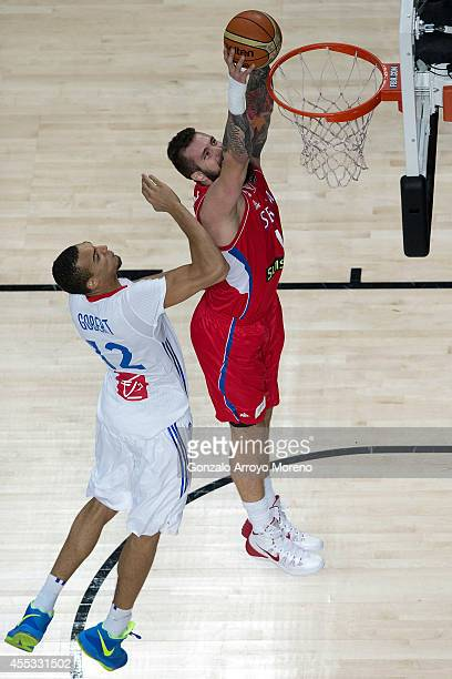 Miroslav Raduljica of Serbia shoots against Rudy Gobert of France during the 2014 FIBA World Basketball Championship semifinal match between France...