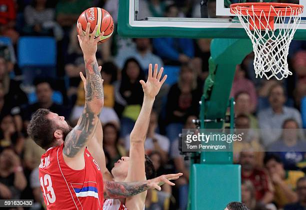 Miroslav Raduljica of Serbia shoots the ball against Darko Planinic of Croatia during the Men's Basketball Quarterfinal game at Carioca Arena 1 on...