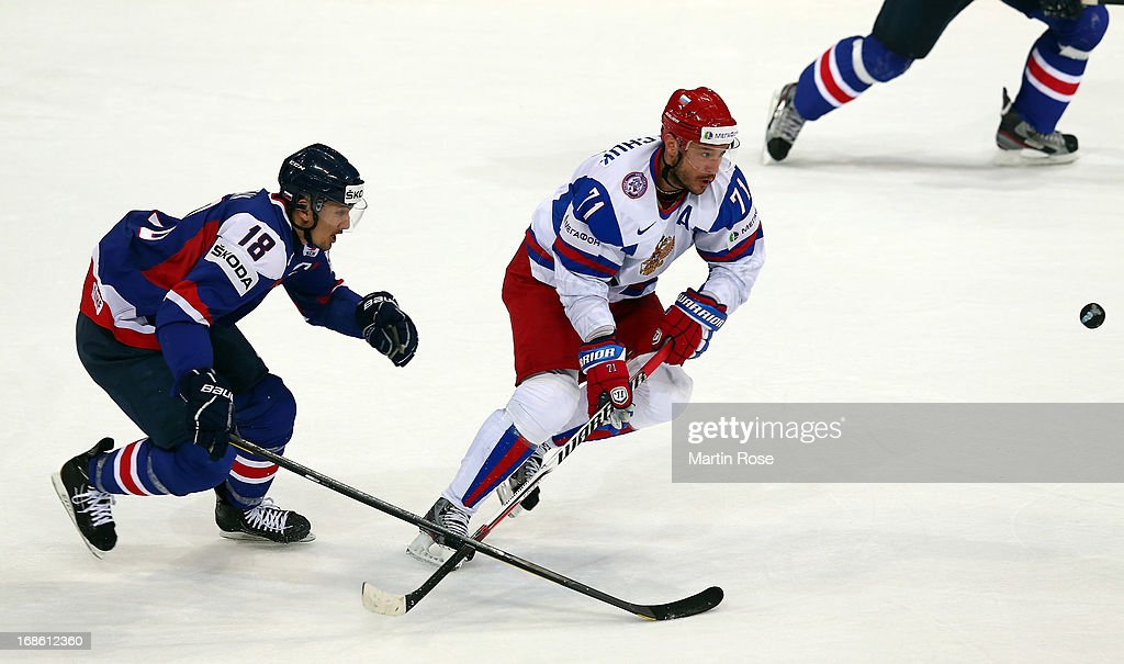 Miroslav Satan (L) of Slovakia and Ilya Kovalchuk (R) of Russia battle for the puck during the IIHF World Championship group H match between Slovakia and Russia at Hartwall Areena on May 12, 2013 in Helsinki, Finland.