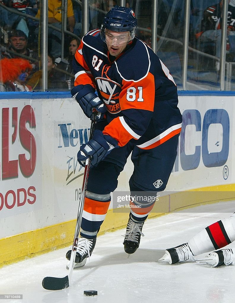 Miroslav Satan #81 of the New York Islanders carries the puck around the end boards against the Carolina Hurricanes during their NHL game on January 21, 2008 at Nassau Coliseum in Uniondale, New York. The Hurricanes defeated the Islanders 3-2 in overtime.