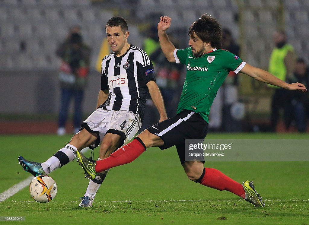 Miroslav Vulicevic (L) of FK Partizan in action against Benat Etxebarria (R) of Athletic Club during the UEFA Europa League match between FK Partizan v Athletic Club at Stadium FK Partizan on October 22, 2015 in Belgrade, Serbia.
