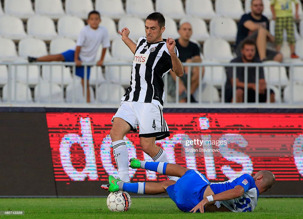 Miroslav Vulicevic (L) of FK Partizan in action against Ivica Jovanovic (R) of OFK Belgrade during the Serbia Super League match between FK Partizan and OFK Belgrade at Partizan stadium on August 29, 2015 in Belgrade, Serbia.