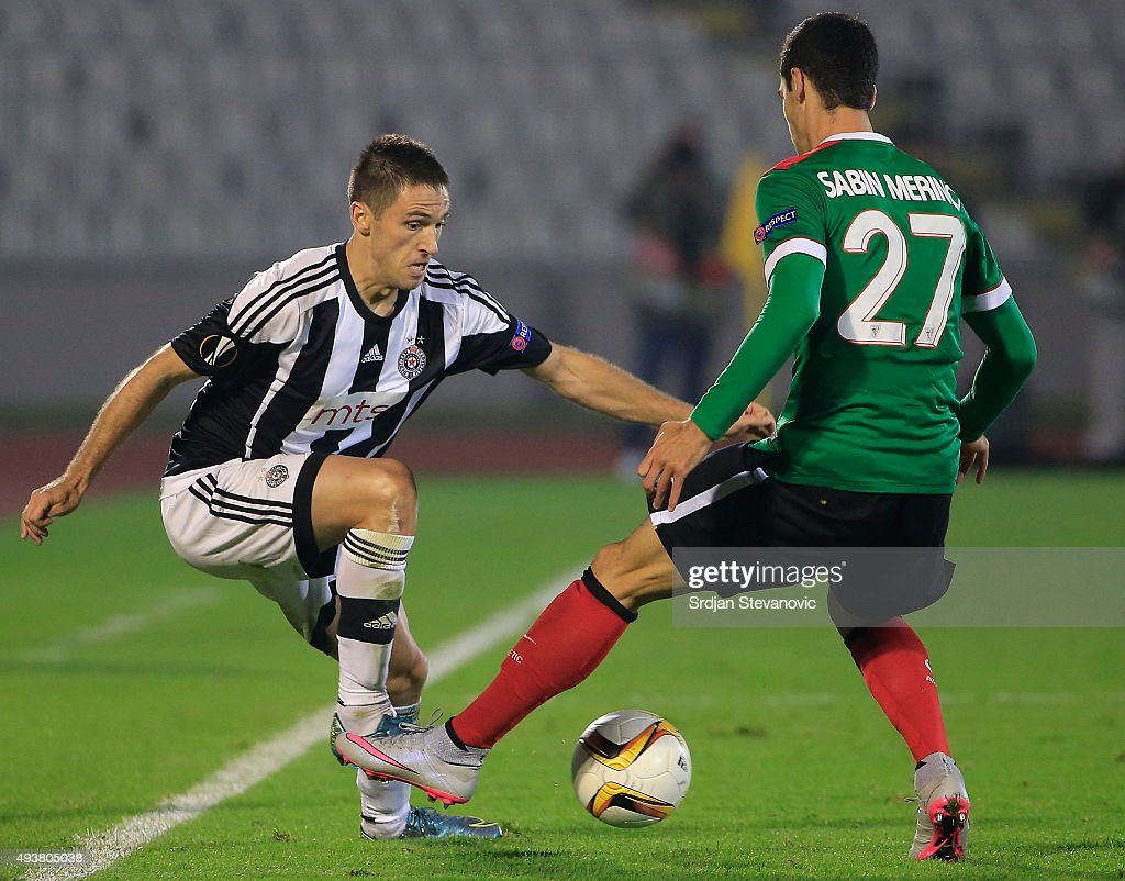 Miroslav Vulicevic (L) of FK Partizan in action against Sabin Merino (R) of Athletic Club during the UEFA Europa League match between FK Partizan v Athletic Club at Stadium FK Partizan on October 22, 2015 in Belgrade, Serbia.