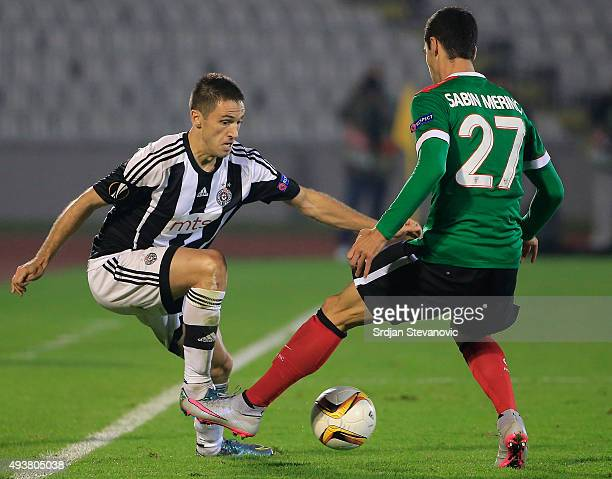 Miroslav Vulicevic of FK Partizan in action against Sabin Merino of Athletic Club during the UEFA Europa League match between FK Partizan v Athletic...