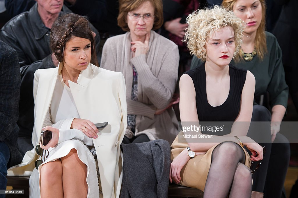 Miroslava Duma (L) and actress Julia Garner attend Philosophy By Natalie Ratabesi during fall 2013 Mercedes-Benz Fashion Week on February 13, 2013 in New York City.