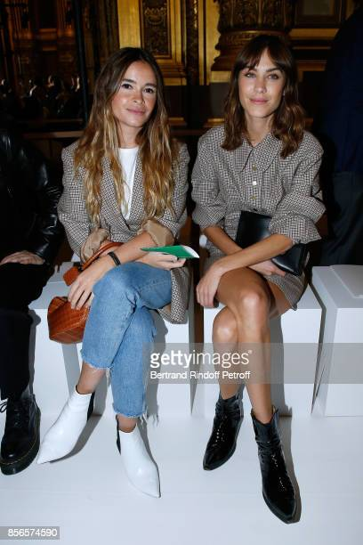 Miroslava Duma and Alexa Chung attend the Stella McCartney show as part of the Paris Fashion Week Womenswear Spring/Summer 2018 on October 2 2017 in...