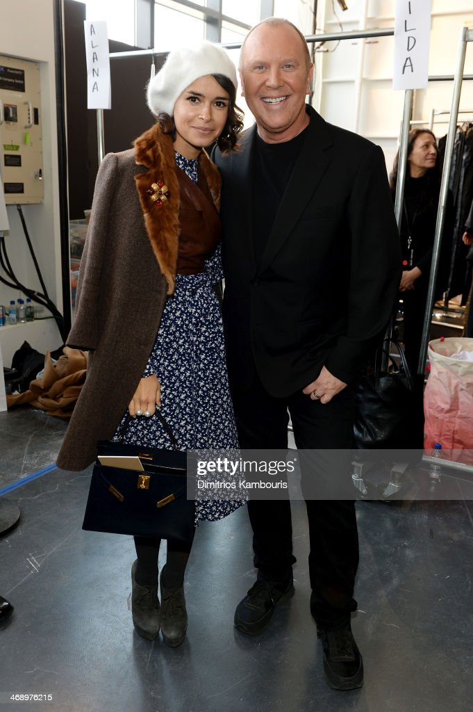 Miroslava Duma (L) and designer Michael Kors pose backstage at the Michael Kors fashion show during Mercedes-Benz Fashion Week Fall 2014 at Spring Studios on February 12, 2014 in New York City.
