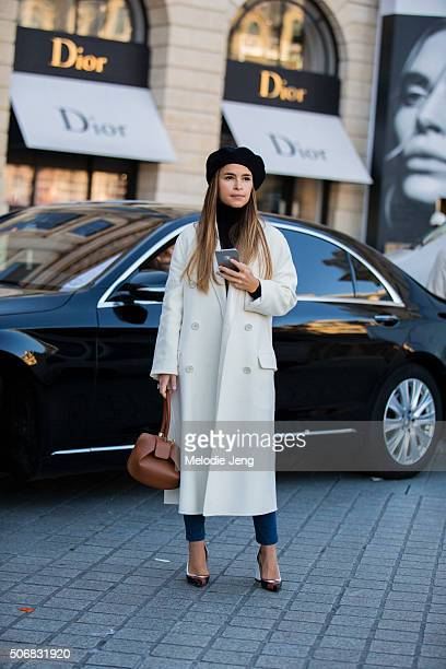 Miroslava Duma attends the Schiaparelli show in a white coat and black beret on January 25 2016 in Paris France
