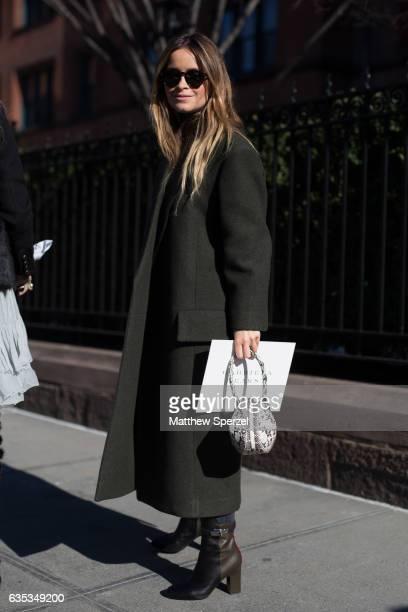 Miroslava Duma is seen attending Gabriela Hearst during New York Fashion Week wearing an army green coat on February 14 2017 in New York City