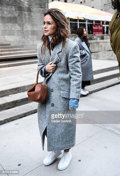 Miroslava Duma is seen outside the Alexander Wang show wearing a grey coat during New York Fashion Week Women's Fall/Winter 2016 on February 13 2016...