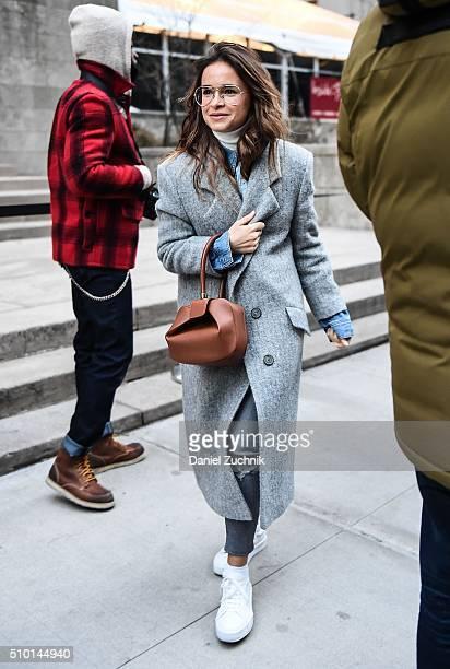Miroslava Duma is seen outside the Alexander Wang show wearing a grey coat during New York Fashion Week: Women's Fall/Winter 2016 on February 13,...