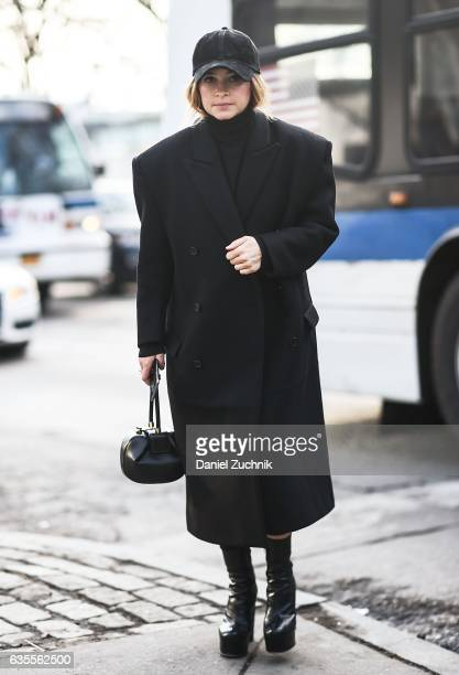 Miroslava Duma is seen wearing a black coat black turtleneck black hat and black purse outside the Yeezy Kanye West show during New York Fashion Week...