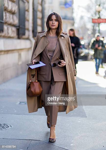 Miroslava Duma wearing a beige coat and suit and Loewe bag outside Hermes during the Paris Fashion Week Womenswear Fall/Winter 2016/2017 on March 7...