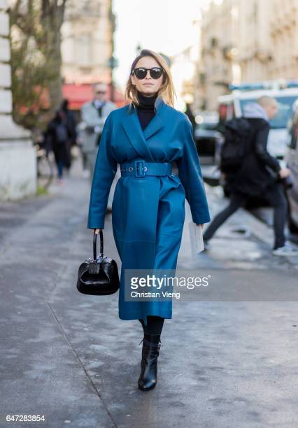 Miroslava Duma wearing a belted blue coat outside Chloe on March 2 2017 in Paris France