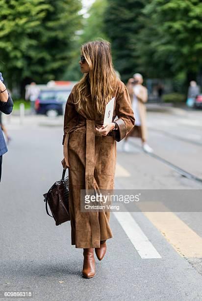 Miroslava Duma wearing a brown coat outside Fendi during Milan Fashion Week Spring/Summer 2017 on September 22 2016 in Milan Italy