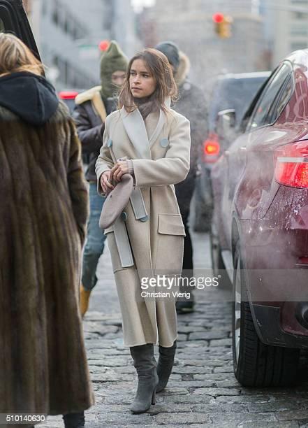 Miroslava Duma wearing a creme wool coat and a beret seen outside Jason Wu during New York Fashion Week Women's Fall/Winter 2016 on February 12 2016...