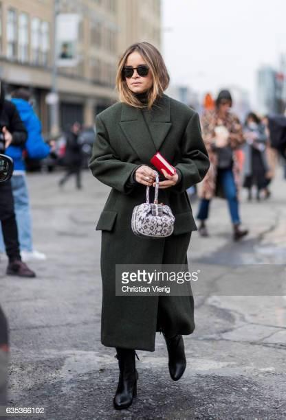 Miroslava Duma wearing a green coat outside Tory Burch on February 14 2017 in New York City