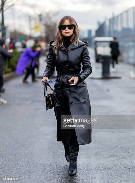 Miroslava Duma wearing a long leather coat seen outside Coach during New York Fashion Week Women's Fall/Winter 2016 on February 16 2016 in New York...