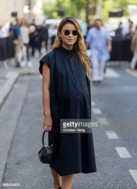 Miroslava Duma wearing a navy dress outside Valentino during Paris Fashion Week Menswear Spring/Summer 2018 on June 21 2017 in Paris France