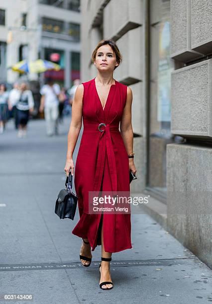Miroslava Duma wearing a red dress outside Victoria Beckham on September 11 2016 in New York City