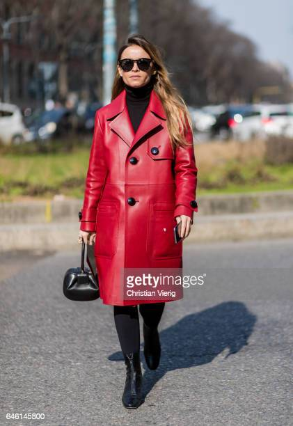 Miroslava Duma wearing a red leather coat outside Armani during Milan Fashion Week Fall/Winter 2017/18 on February 27 2017 in Milan Italy