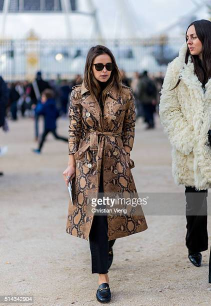 Miroslava Duma wearing a snakeskin leather coat outside Elie Saab during the Paris Fashion Week Womenswear Fall/Winter 2016/2017 on March 5 2016 in...