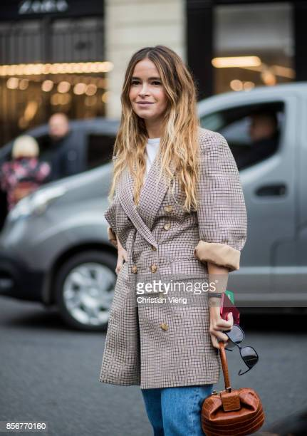 Miroslava Duma wearing checked blazer seen outside Stella McCartney during Paris Fashion Week Spring/Summer 2018 on October 2 2017 in Paris France