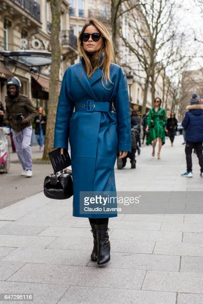 Miroslava Duma wears a blue coat outside the Balmain show during Paris Fashion Week Womenswear Fall/Winter 2017/2018 on March 2 2017 in Paris France