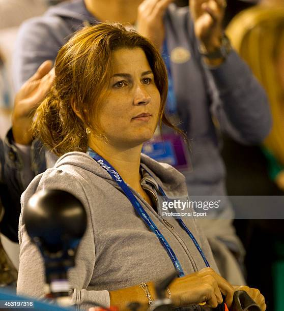 Miroslava Federer wife of Roger Federer watches the men's third round match between Roger Federer of Switzerland and Bernard Tomic of Australia...