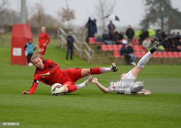 Mirri Taylor of England brings down Klara Buhl of Germany for a penalty during Women's U16s International Friendly match between England U16s Women...