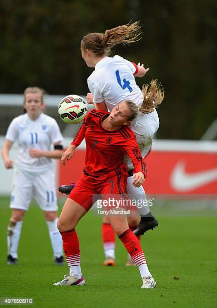 Mirri Taylor of England is tackled by Klara Buhl of Germany during Women's U16s International Friendly match between England U16s Women and Germany...