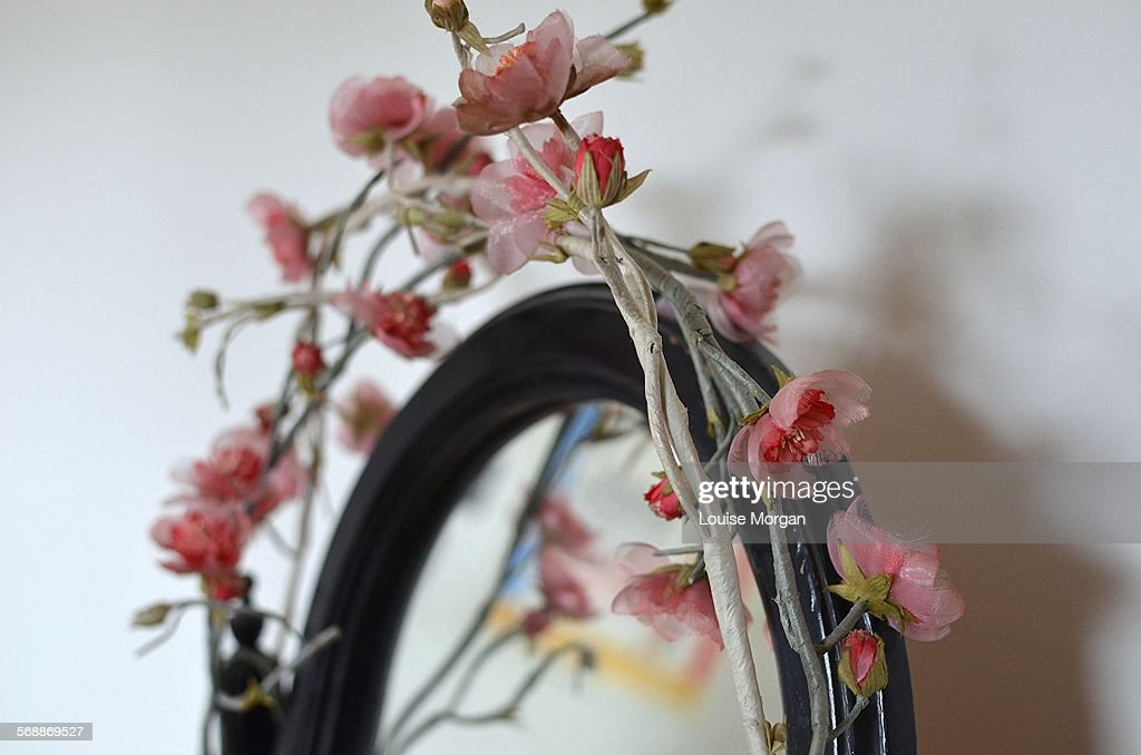 Mirror and flower garland : Stock Photo