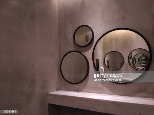 mirror in bathroom - oppie muharti stock pictures, royalty-free photos & images