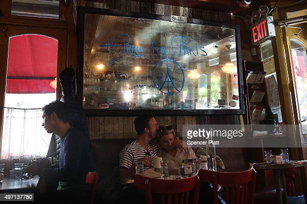 A mirror in the Brooklyn French restaurant Bar Tabac reads Pray For Paris the day after an attack on civilians in Paris on November 14 2015 in New...