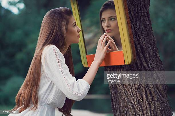 mirror mirror... - woman in mirror stock photos and pictures