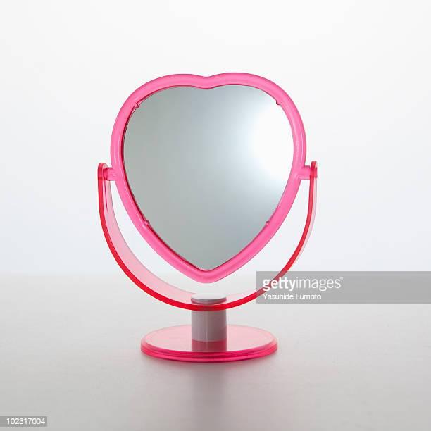 A mirror of heart shape.