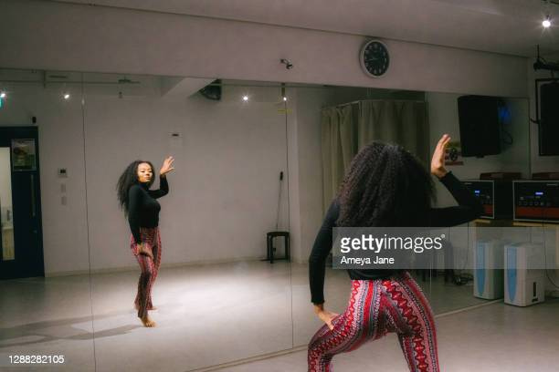 mirror reflection of female dancer rehearsing in studio - showus stock pictures, royalty-free photos & images