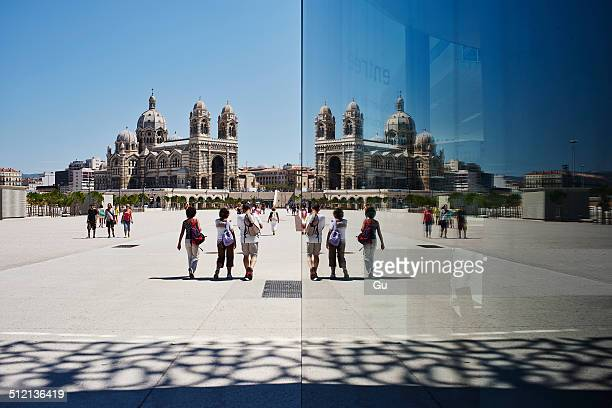 Mirror reflection of tourists and Marseille cathedral, Marseille, France