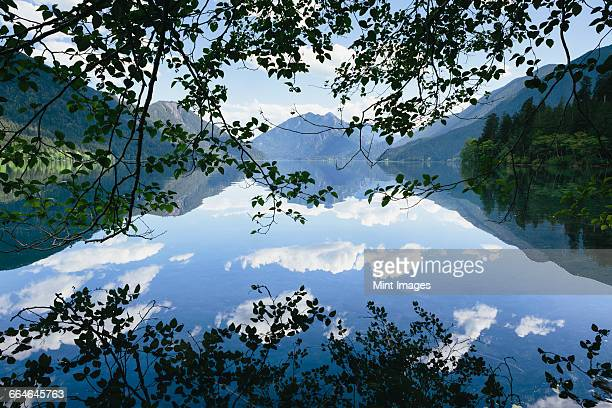 Mirror reflections, the sky and clouds reflected in the surface of hte water of Lake Crescent.