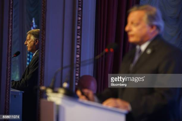A mirror reflects Juan Jose Aranguren Argentina'senergy and mining minister speaking during the Americas Society and Council of the America annual...