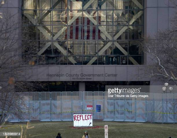 Mirror with a rose on it, part of an art installation by Visual Black Justice, is visible outside the Hennepin County Government Center as the trial...
