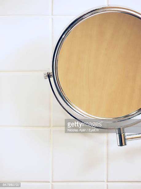 Mirror With Reflection On Bathroom Wall